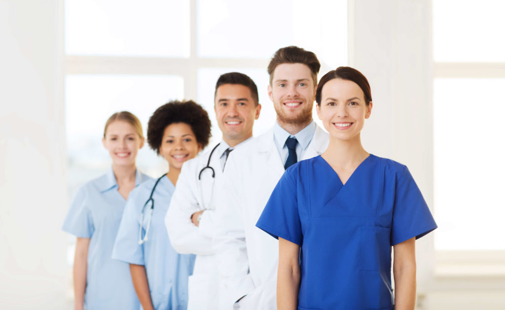 team of medical technology employees smiling